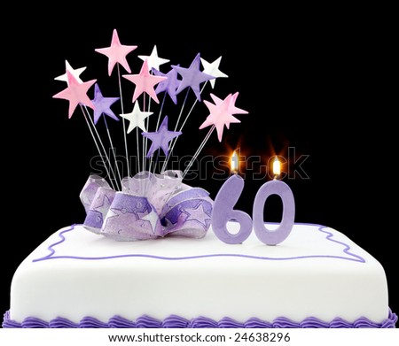 Fancy cake with number 60 candles.  Decorated with ribbons and star-shapes, in pastel tones on black background.