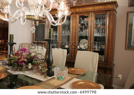 Fancy Dining Room With Cabinet Full Of Crystal Stock Photo 6499798