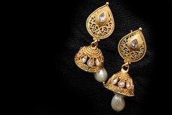 Fancy gold look ear rings close up image for woman fashion. Macro look of  Latest design.