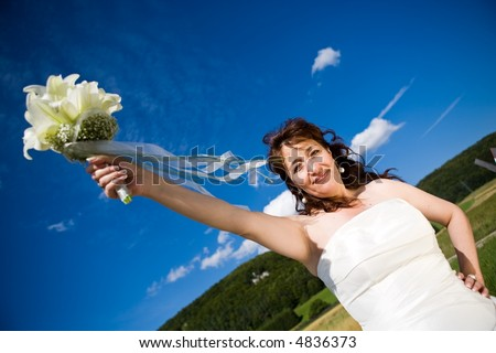 stock photo Fancy Perspective Bride holds her bridal bouquet on