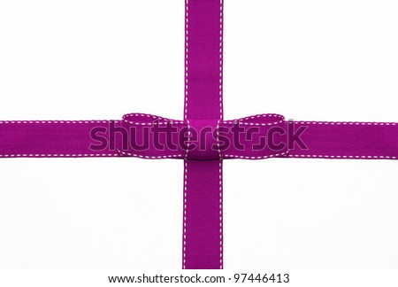 Fancy pink ribbon gift bow with white stitching on white background - stock photo