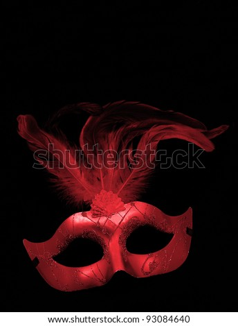 Fancy Red Feathered Mask isolated on a black velvet background