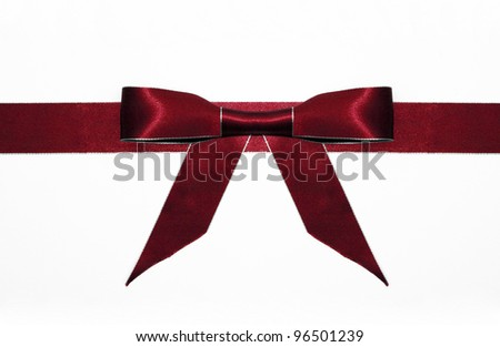 Fancy red ribbon gift bow with silver trim isolated on white background