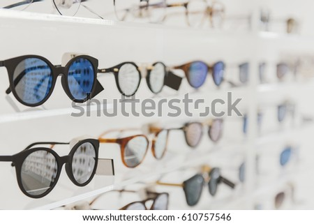 Fancy sunglasses in a store. #610757546
