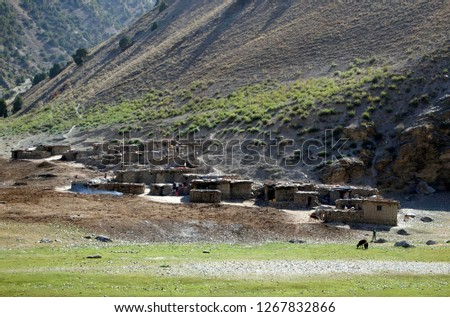 Fann mountains foothills / Tajikistan - August, 19, 2017: mountain village at the Fann foothills. Authentic traditional village (inhabited mostly in summer) with typical stone buildings.  #1267832866