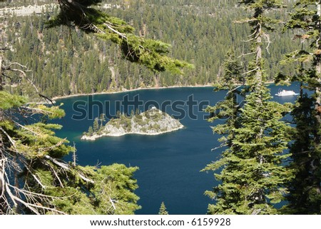Fannette Island in Emerald Bay at Lake Tahoe USA, with a Paddlewheel Boat approaching.
