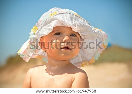 stock photo Fanny infant girl in sun with sun hat girls fannys