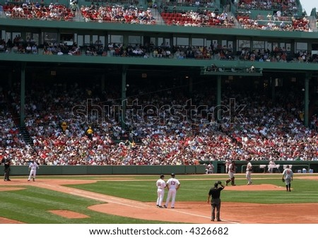 fans and baseball players at fenway park