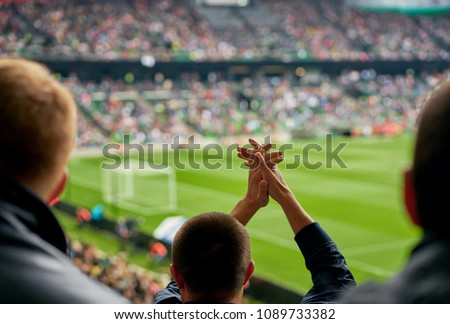 fans at the football match #1089733382