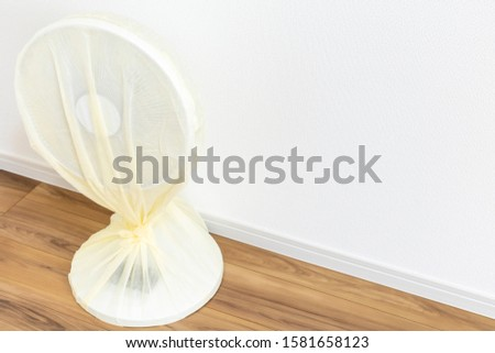 Fans cleaned and covered with sheets