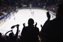 Fans support team in ice hockey stadium - happy people applause after winning goal..