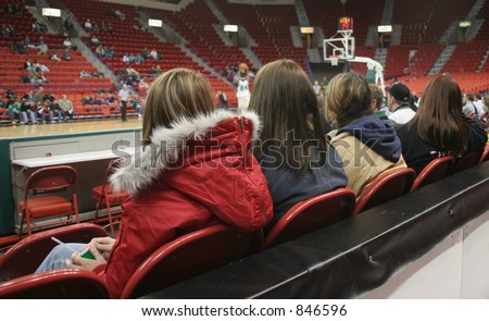 Fans watching a college basketball game