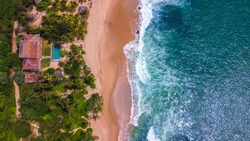 Fantastic Aerial View From Drone to the Sandy Ocean Beach and a Luxury Resort With a Swimming Pool | Hiriketiya Beach, Sri Lanka