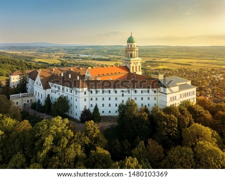 Fantastic arieal video of  Pannonhalama Benedictine abbey in Hungary. Amazing historical building with a beautiful church and library. Popular turist destination with guided tours