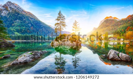 Fantastic autumn sunrise of Hintersee lake. Beautiful scene of trees on a rock island. Location: resort Ramsau, National park Berchtesgadener Land, Upper Bavaria, Germany Alps, Europe