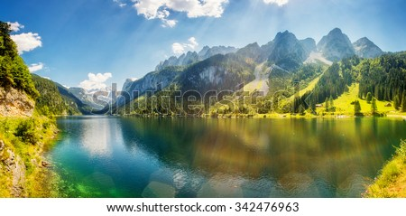 Fantastic azure alpine lake Vorderer Gosausee. Unusual and picturesque scene. Salzkammergut is a famous resort area located in the Gosau Valley in Upper Austria. Dachstein glacier. Beauty world.