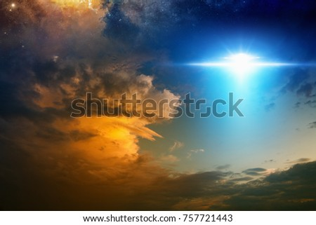 Fantastic background - bright light from extraterrestrial aliens spaceship, ufo  in red glowing sunset sky. Elements of this image furnished by NASA
