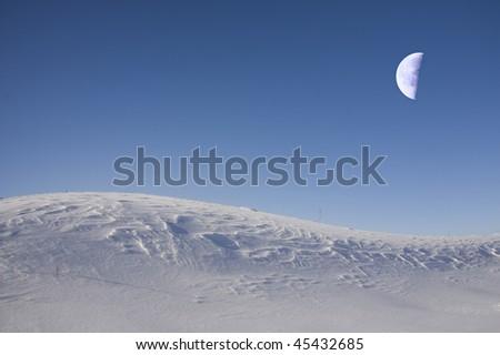 Fantastic beautiful moon shines(covers) snow desert