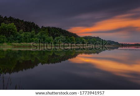 Fantastic beautiful sunset evening view on lake in Stradch, Lviv district. june 2020. Long exposure shot.