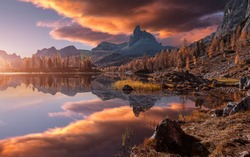 Fantastic colorful scenery in mountains during sunset. Fabulous landscape over calm mountain lake Federa in the summer morning, picture of Wild area. Stunning Natural Background. Creative image