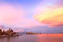 Fantastic colors over Mono Lake with lenticular clouds moving over it at a twilight