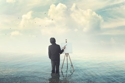 fantastic creative painter with easel drawing on canvas