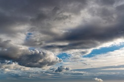 Fantastic dark blue thunderclouds at sunrise, natural composition