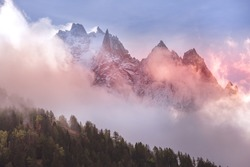 Fantastic evening snow mountains landscape background. Colorful pink and blue clouds overcast sky. French Alps, Chamonix Mont-Blanc, France