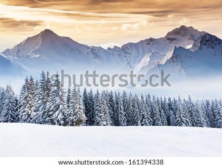 Stock Photo Fantastic evening winter landscape. Dramatic overcast sky. Creative collage. Beauty world.