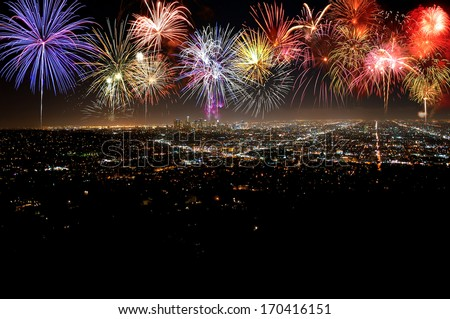 Fantastic festive new years colorful fireworks over city in celebration night #170416151