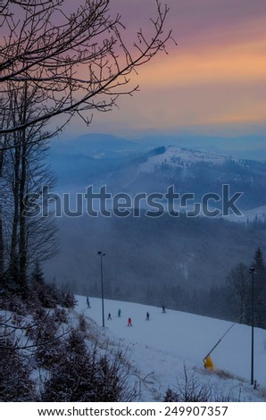 Fantastic foggy winter landscape with sun reflection. Carpathian, Ukraine