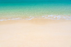 Fantastic golden sand beach with clear blue water. Summer outdoor nature holiday serenity. Beautiful clean sandy beach with soft blue ocean wave. Background, copy space or space for text.