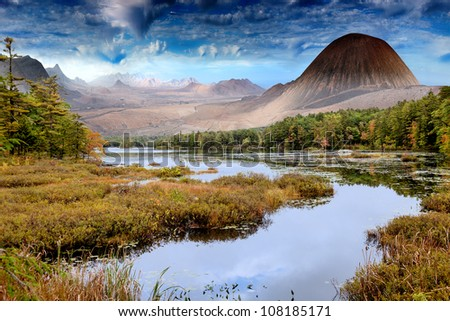 Fantastic landscape with lake and mountains