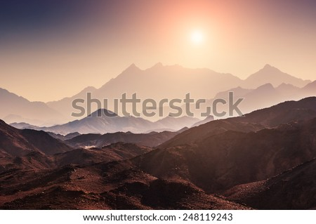 Fantastic landscape with mountains at sunset. Arabian desert, Egypt. Beautiful nature. Creative toning effect