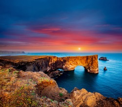 Fantastic large arch of lava in Atlantic Ocean on the coast. Location place Sudurland, cape Dyrholaey, Iceland, Vik village, Europe. Photo of popular tourist attraction. Discover the beauty of earth.