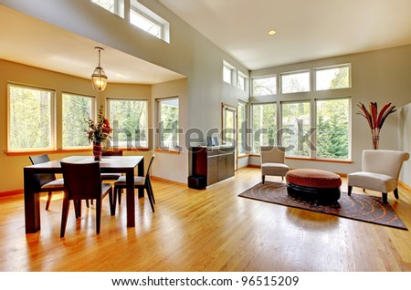 Fantastic modern living room home interior. Dining room. Huge green bright room with modern furniture.