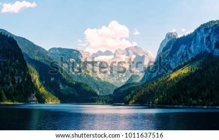 Fantastic morning on mountain lake Gosausee, located in the Austia. Dramatic unusual scene. Alps, Europe. Landscape photography