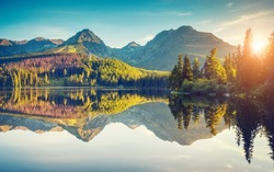 Fantastic mountain lake in National Park High Tatra. Strbske pleso, Slovakia, Europe. Dramatic unusual scene. Beauty world. Retro and vintage style, soft filter. Instagram toning effect.