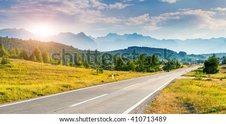 Fantastic mountain range glowing at sunlight. Dramatic and picturesque scene. Location famous place National park Durmitor, Balkans. Village Zabljak, Montenegro, Europe. Beauty world. Warm toning.