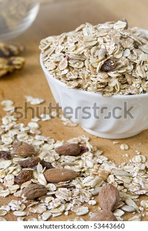 Fantastic muesli with nuts on wooden table