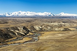 Fantastic natural landscape with mountain covered snow and river Kyzyl-Chin, Altai Republic, Russia. Nature environment landmark.