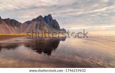 Fantastic panorama of Mount Vestrahorn at low tide at sunrise. Incredible summer morning on the Stokksnes headland. Southeastern Iceland, Europe. Visit Iceland. Beauty world.