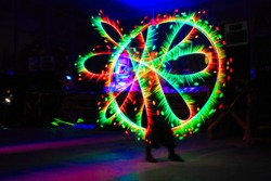 Fantastic photo of flame man raver filmed in fluorescent colors with led panel that is mimicking UV light.