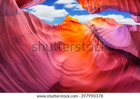 Fantastic slot canyon Antelope in the Navajo reservation. Mysterious red tunnel under the blue sky. Arizona, USA
