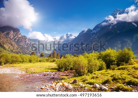 Fantastic snow peaks of Mt. Ushba in the morning light. Picturesque and gorgeous scene. Location place Svaneti, Mestia, Georgia, Europe. High Caucasus ridge. Artistic picture. Beauty world. #497193616
