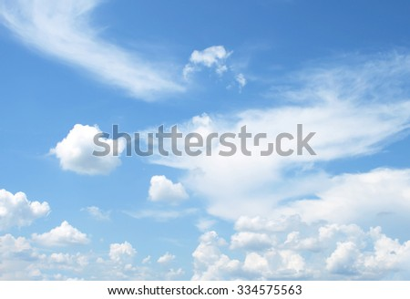 Fantastic soft white clouds against blue sky #334575563