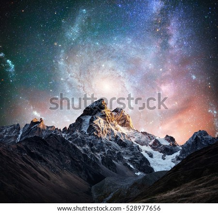 Fantastic starry sky. Snow-capped peaks. Main Caucasian Ridge. Courtesy of NASA. Mountain View from Mount Ushba Meyer, Georgia. Europe. #528977656