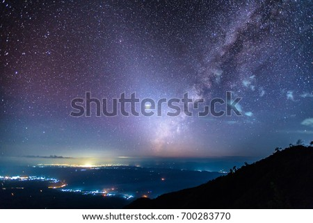 Fantastic starry sky, zodiacal light, milky way, venus and city light view at Den Chang Non Crest, Pha Peung, Pua, Nan, Thailand