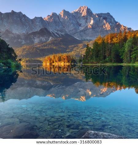 Fantastic sundown on mountain lake Eibsee, located in the Bavaria, Germany. Dramatic unusual scene. Alps, Europe. #316800083