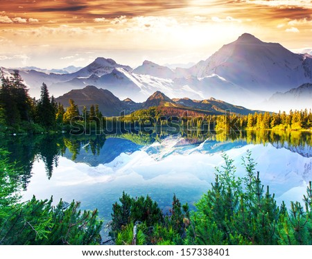 Fantastic sunny day is in mountain lake. Creative collage. Beauty world.